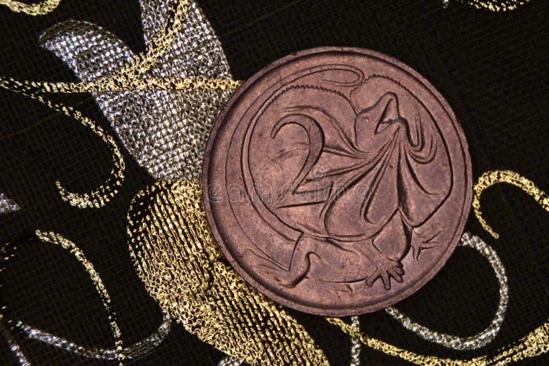 Closeup of an Australian 2 cent coin. Closeup of an Australian 2 cent coin on a dark background royalty free stock image