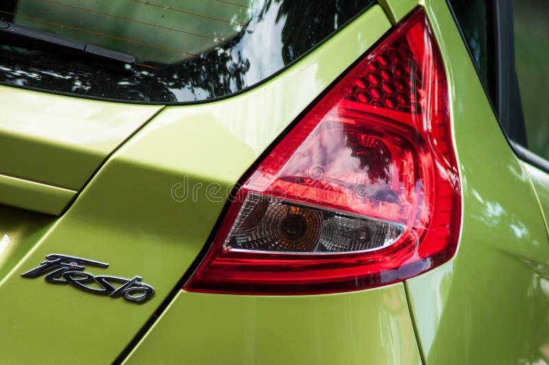 Closeup av bakre ljus och logoen av den gröna vadställefiestaen royaltyfri fotografi