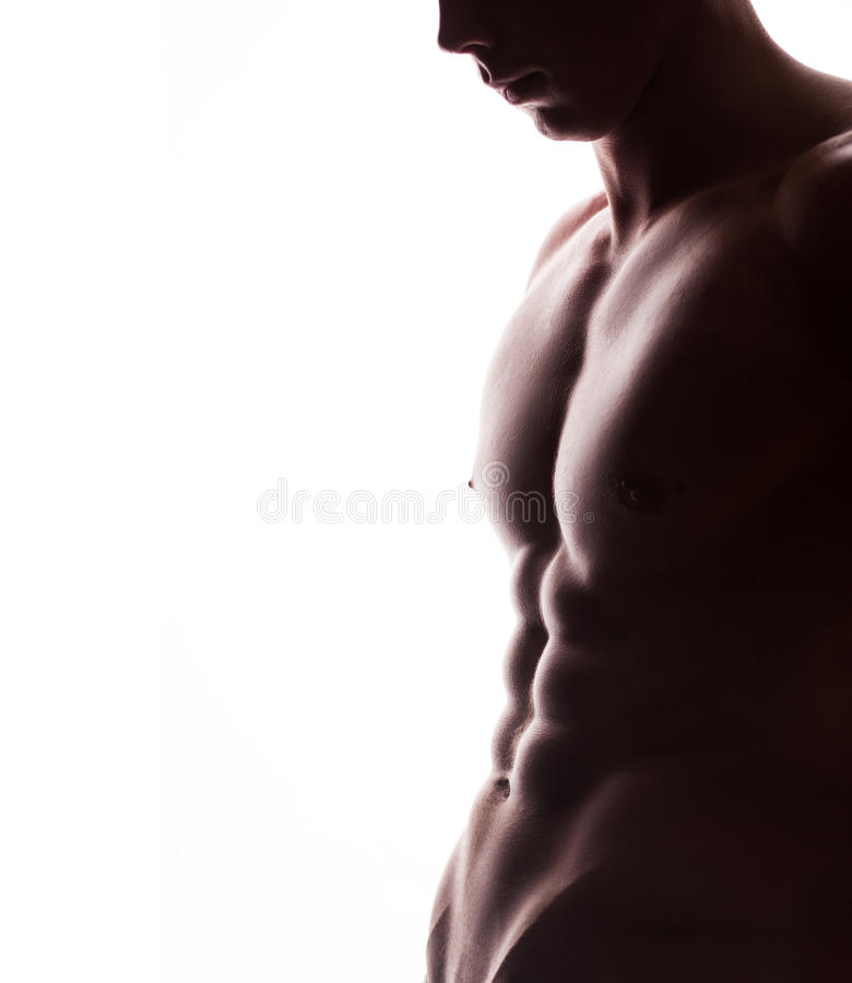Closeup av den starka idrotts- mannen på vit bakgrund royaltyfri bild