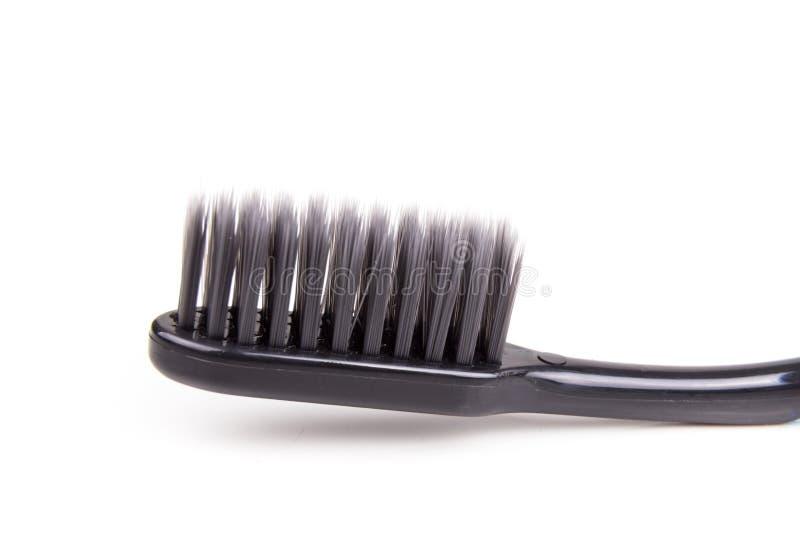 Closeup av det mjuka och slanka koniska borstet för tandborstekol royaltyfri foto