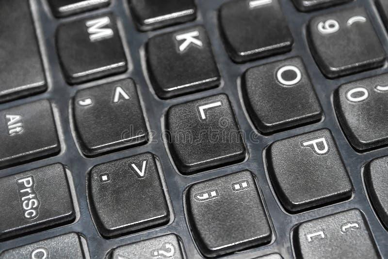 Closeup av det svarta bärbar datortangentbordet arkivbilder