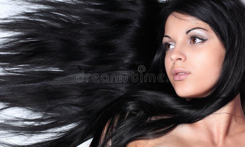 Closeup av en kvinnlig framsida på Black royaltyfri foto