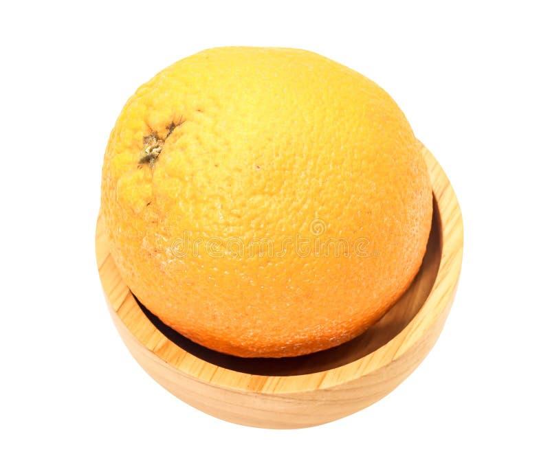 Closeup av en orange Sunkist på trä fotografering för bildbyråer