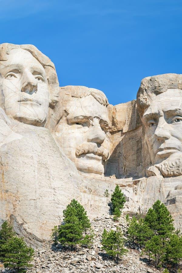 Closeup av George Washington, Thomas Jefferson och Abraham Lincoln Presidents- skulptur på Mount Rushmore den nationella monument arkivfoton