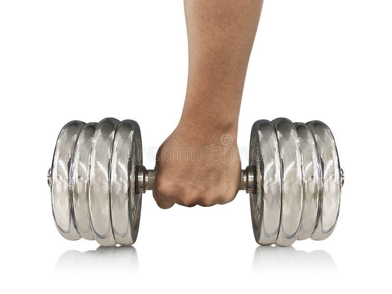 Closeup av muskulösa lyftande vikter för en ung man på vit bakgrund royaltyfria foton