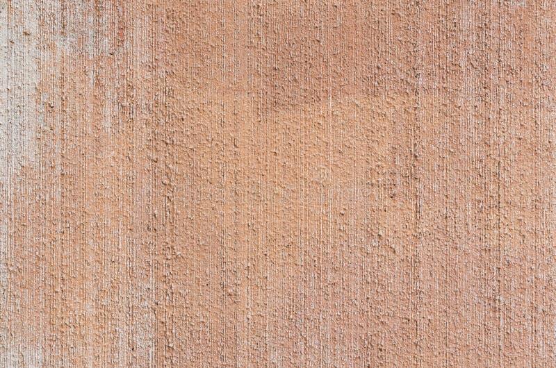 Closeup av packad och målad peachy väggbakgrund royaltyfria bilder