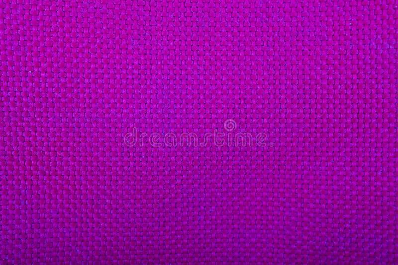 Closeup av purpurfärgat infött stilmaterial för bakgrund royaltyfri bild
