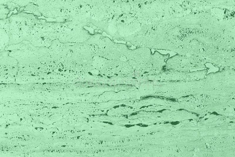 Closeup av texturerade väggen för mintkaramell den kulör porös sten arkivfoton