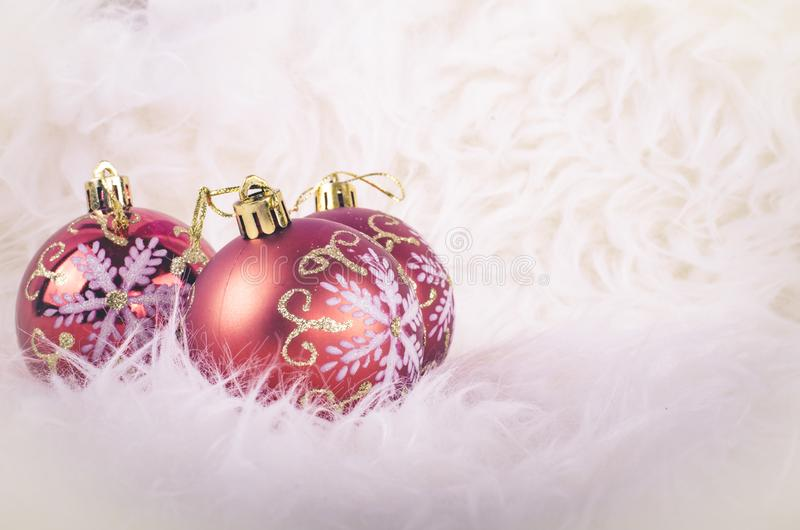 Christmas festival decoration with red ornament ball on fluffy white mat royalty free stock photo