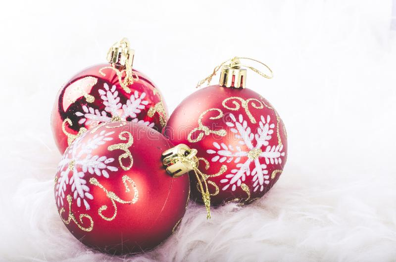 Christmas festival decoration with red ornament ball on fluffy white mat royalty free stock photos
