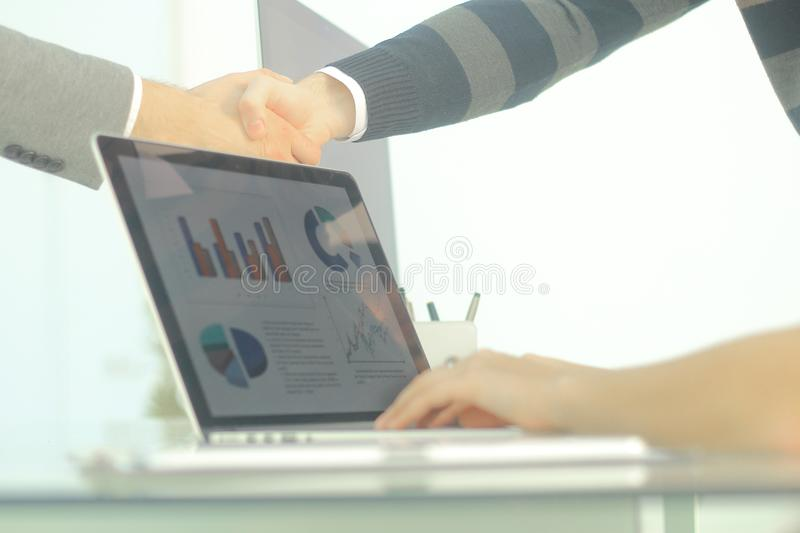 Closeup.background image handshake financial partners stock photo
