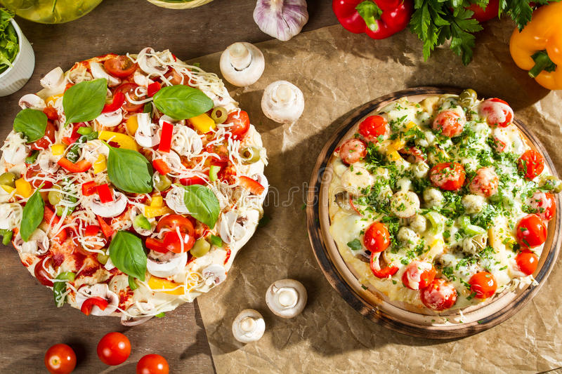Closeup of baked pizza and raw stock image