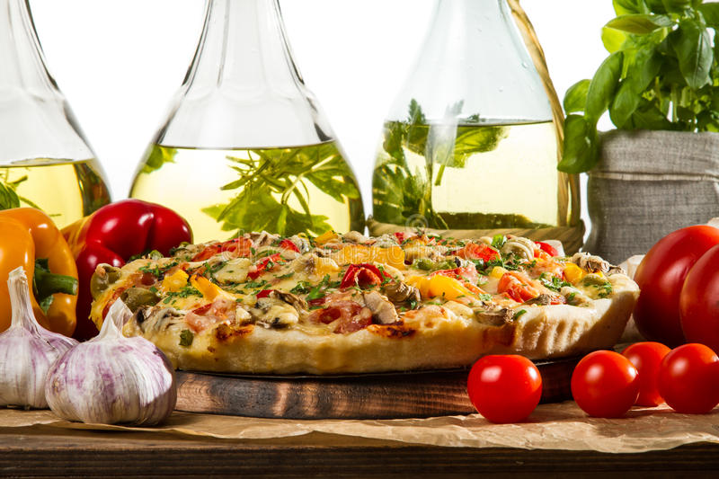 Closeup of baked pizzas royalty free stock photo
