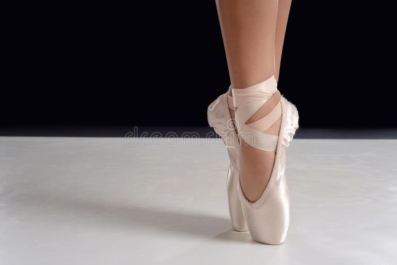 Closeup of ballerina feet on pointe in pointe shoes royalty free stock image