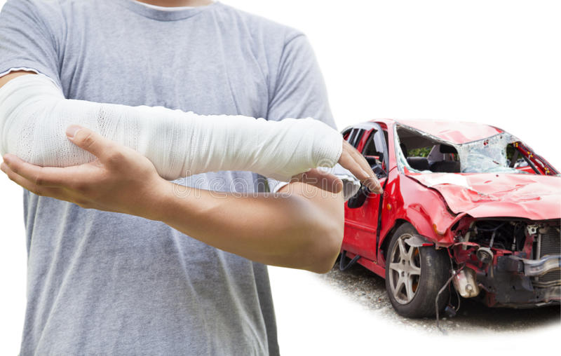 Closeup of bandaged arm with blue wrecked car stock photography