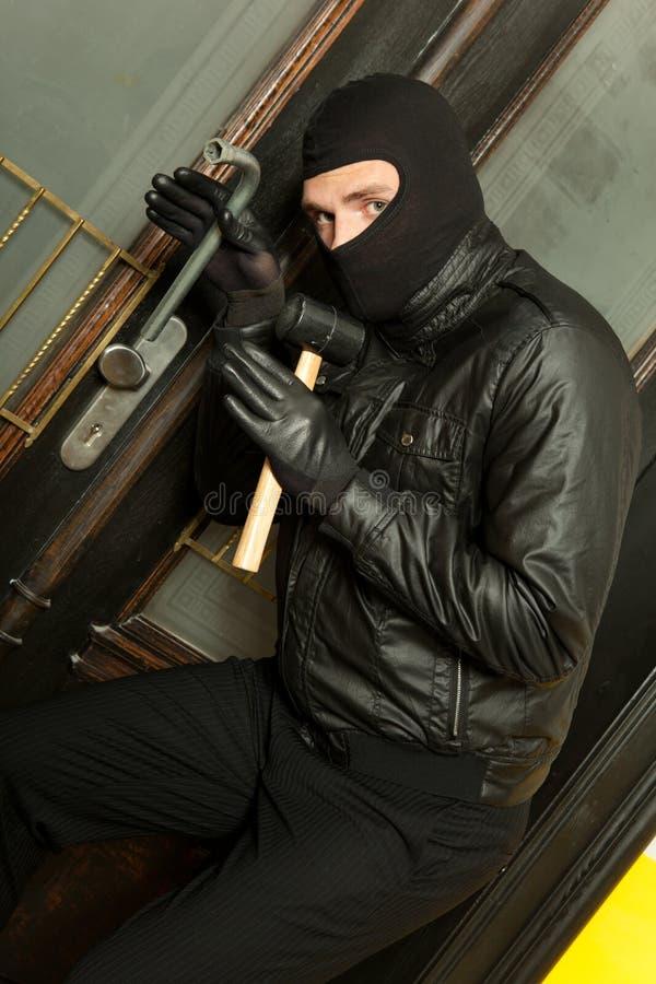 Closeup bandit. Closeup of a bandit at work stock photos