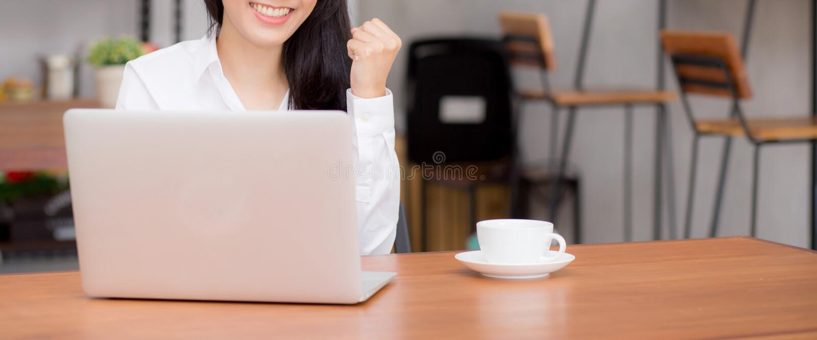 Closeup banner website asian young businesswoman excited and glad of success with laptop royalty free stock photo