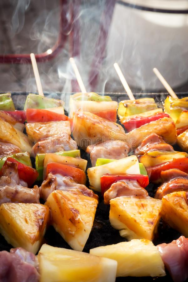 Barbecue stick grilling. Street food in Thailand. Meal and easy. Closeup barbecue stick grilling. Street food in Thailand. Meal and easy eat stock image