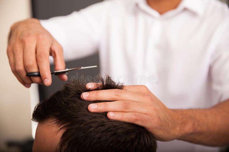 Closeup of a barber at work stock photography