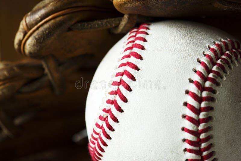 Closeup of baseball ball and gloves stock photography