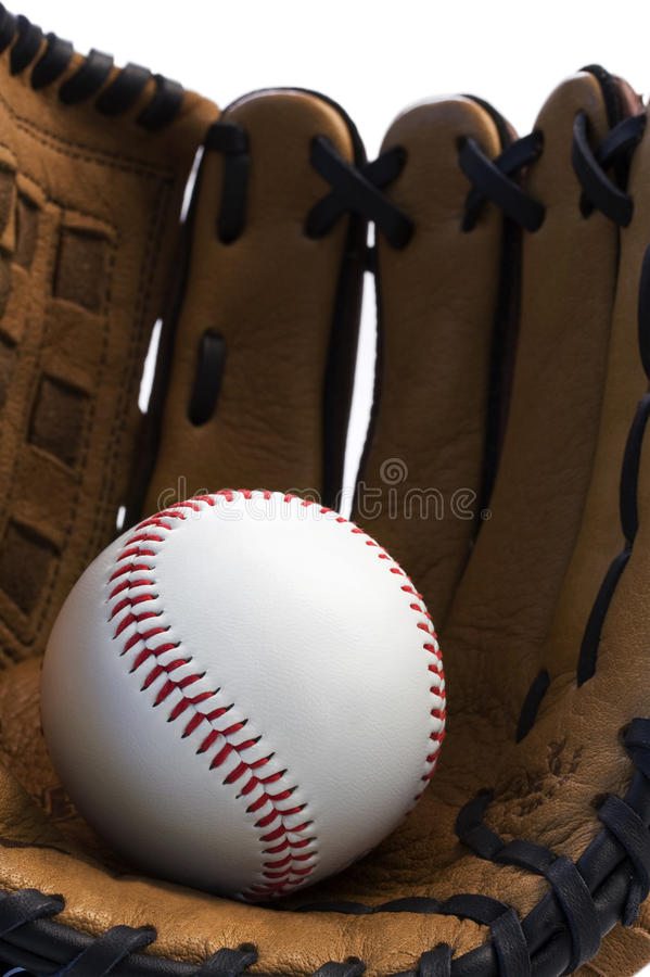 Closeup of baseball glove holding baseball stock photo