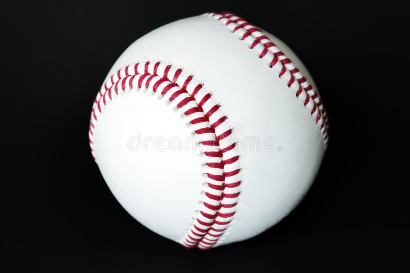 Closeup of baseball isolated on black royalty free stock photos