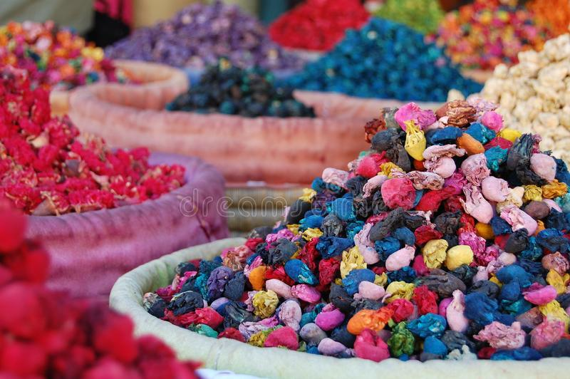 Closeup of a basket with colored powder packs with blurred background in Marrakech royalty free stock photo