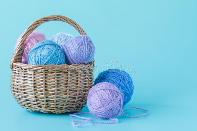 Closeup of basket with colorful yarn clews.Concept of freelance creative working and happy living royalty free stock photo