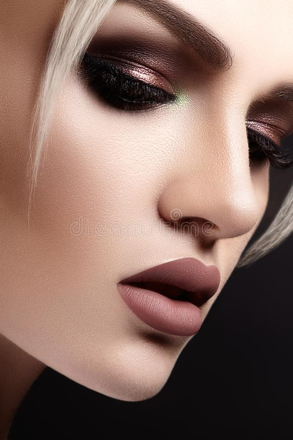 Closeup with of beautiful blond woman. Fashion makeup, clean shiny skin. Makeup and cosmetic. Beauty style on model face stock photo
