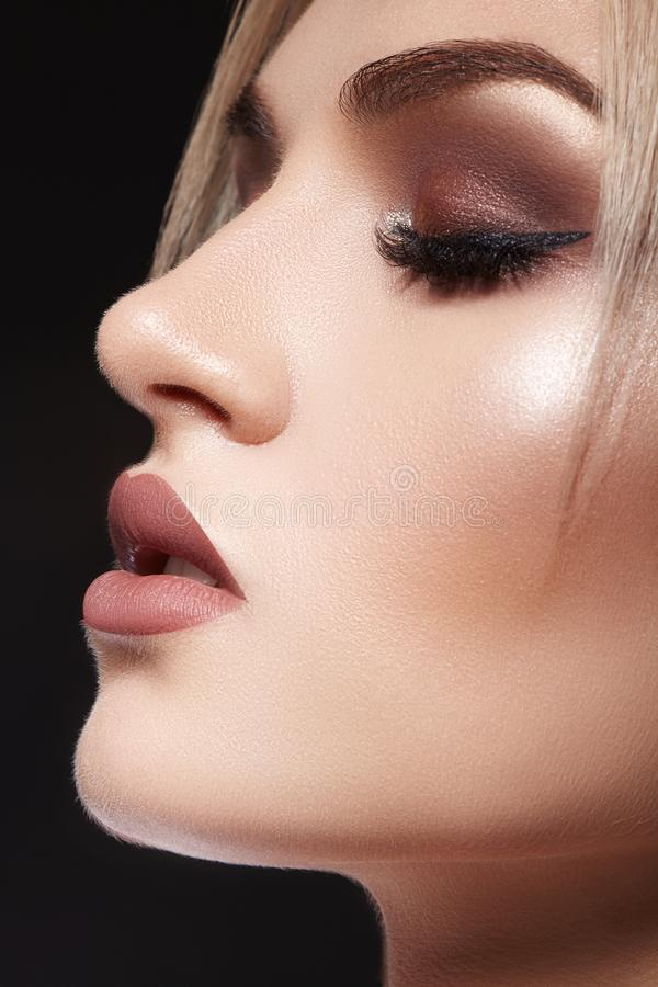 Closeup with of beautiful blond woman. Fashion makeup, clean shiny skin. Makeup and cosmetic. Beauty style on model face royalty free stock photo