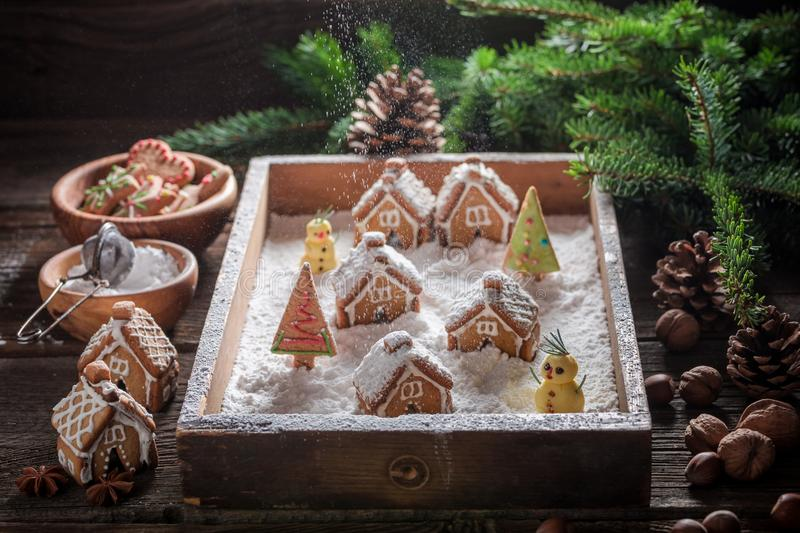 Beautiful Christmas gingerbread village with trees, snow and snowman stock photo