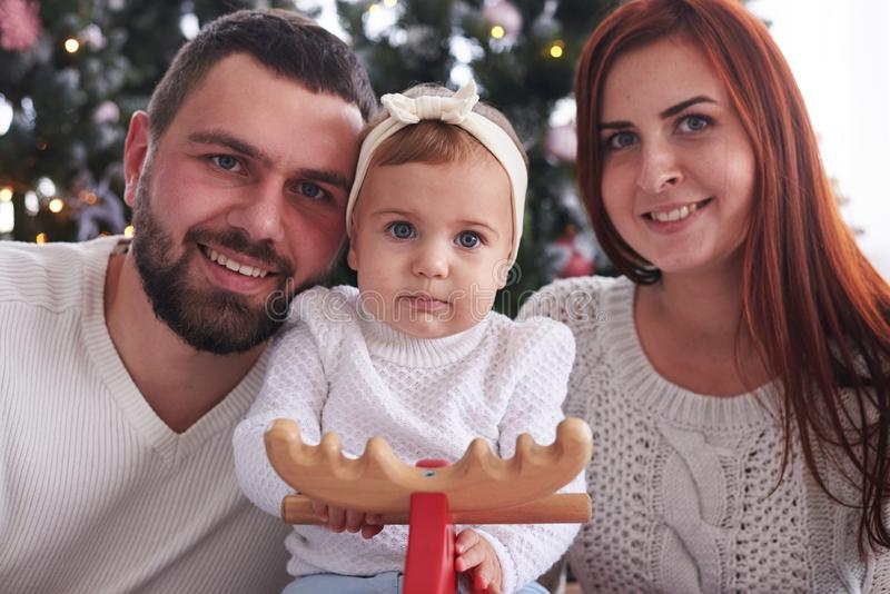 Beautiful Christmas portrait of young family royalty free stock photo