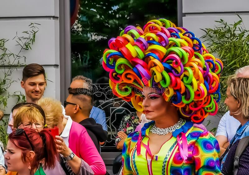 Closeup of a beautiful drag queen in a colorful dress and rainbow wig, Gender diversity, LGBT pride parade antwerp, 10 august,. A closeup of a beautiful drag royalty free stock images