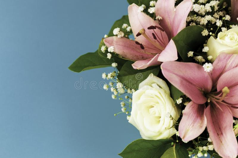 Closeup beautiful flowers in pastel colors on a blue background in vintage processing. Greeting card, mom`s day, wedding royalty free stock photos