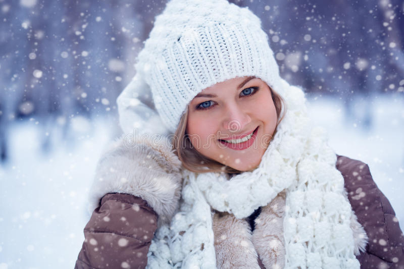 Closeup beautiful happy woman winter portrait stock photo