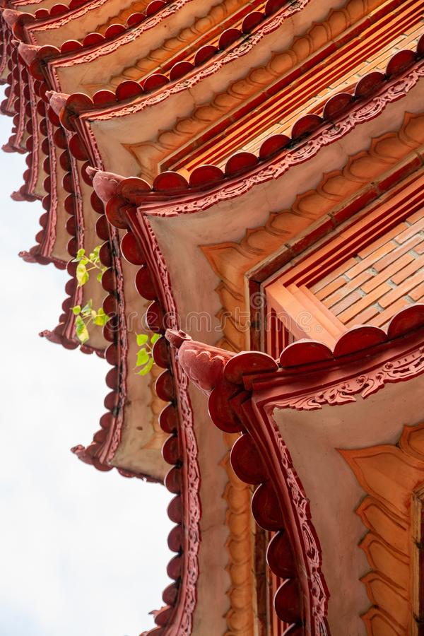 Closeup of roofline architectural details of the Tran Quoc Pagoda, Hanoi, Vietnam. Closeup of the beautiful red and orange repeating roofline of the iconic Tran stock photos