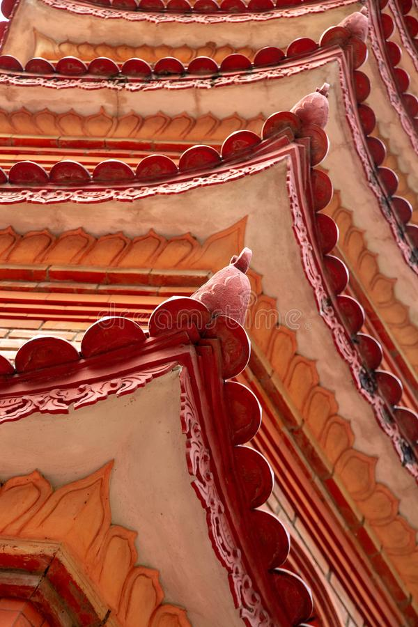 Closeup of roofline architectural details of the Tran Quoc Pagoda, Hanoi, Vietnam. Closeup of the beautiful red and orange repeating roofline of the iconic Tran royalty free stock photography