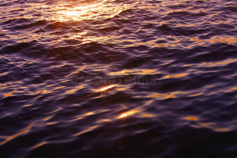 Closeup beautiful shot of body of water with the sun reflecting on it at sunset. A closeup beautiful shot of body of water with the sun reflecting on it at royalty free stock photos