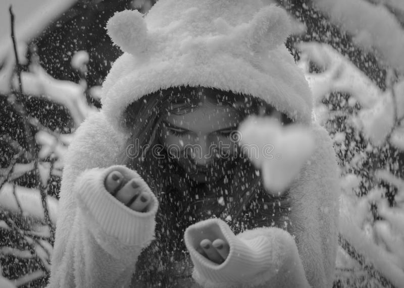 Portrait of cute happy teenage girl in snow, black and white.Winter theme. royalty free stock images