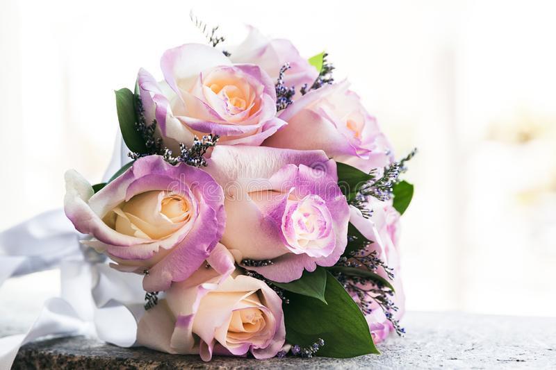 Closeup of beautiful tender wedding bouquet of roses on Wedding day royalty free stock images