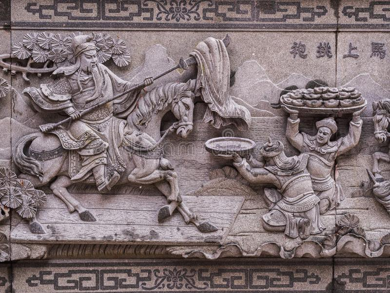 Closeup beautiful wall carving about Guan Yu at Sun Moon Lake Wen Wu Temple. royalty free stock photos