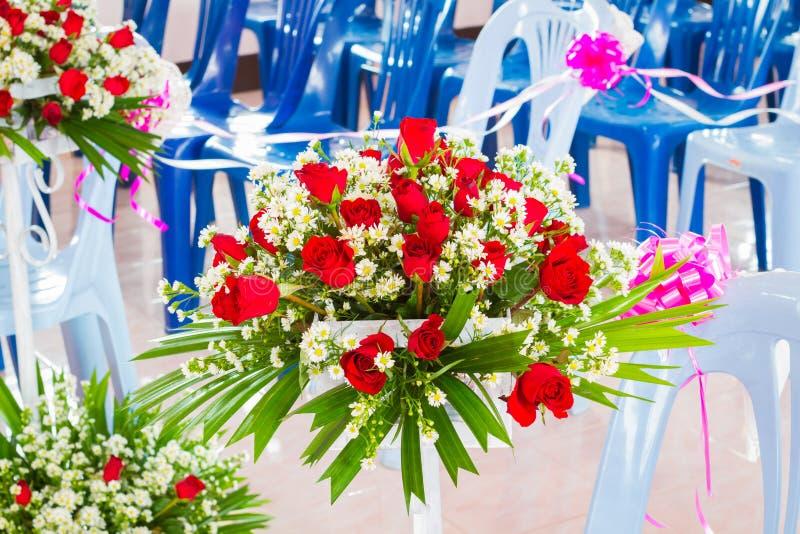 Closeup beautiful wedding flower arrangement of seats along the royalty free stock images