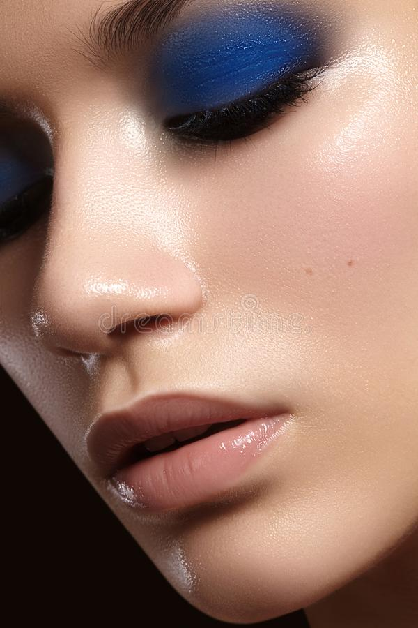 Closeup with of beautiful woman. Fashion makeup, clean shiny skin with highlighter. Makeup and cosmetic. Beauty style stock photos