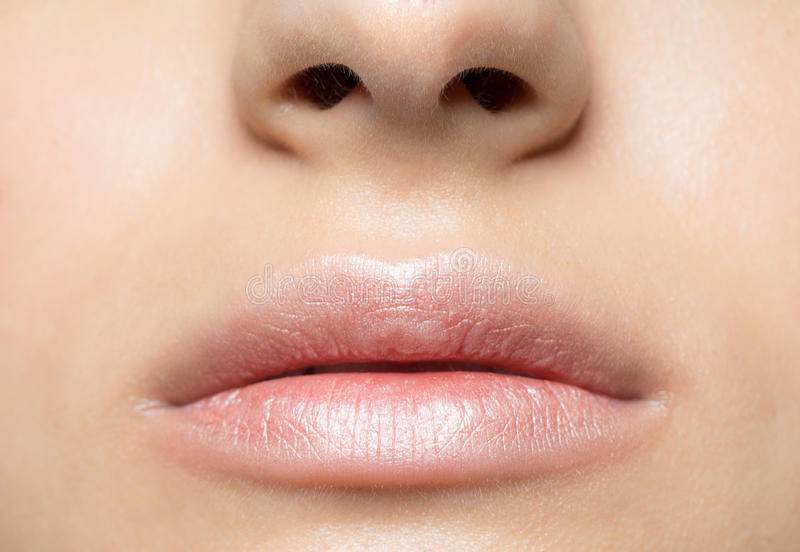 Closeup of beautiful woman lips stock photo