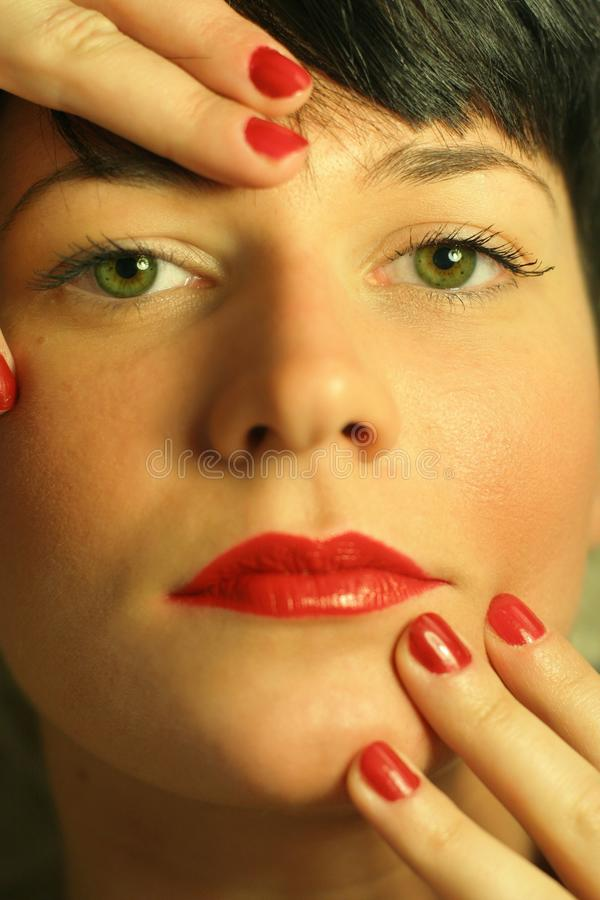 Closeup of a beautiful woman with red lips