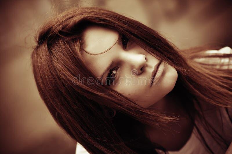 Closeup of beautiful young girl. Faded tones stock images