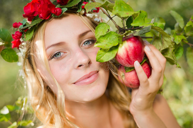 Closeup on beautiful young lady apple fairy with three fruits stock photos