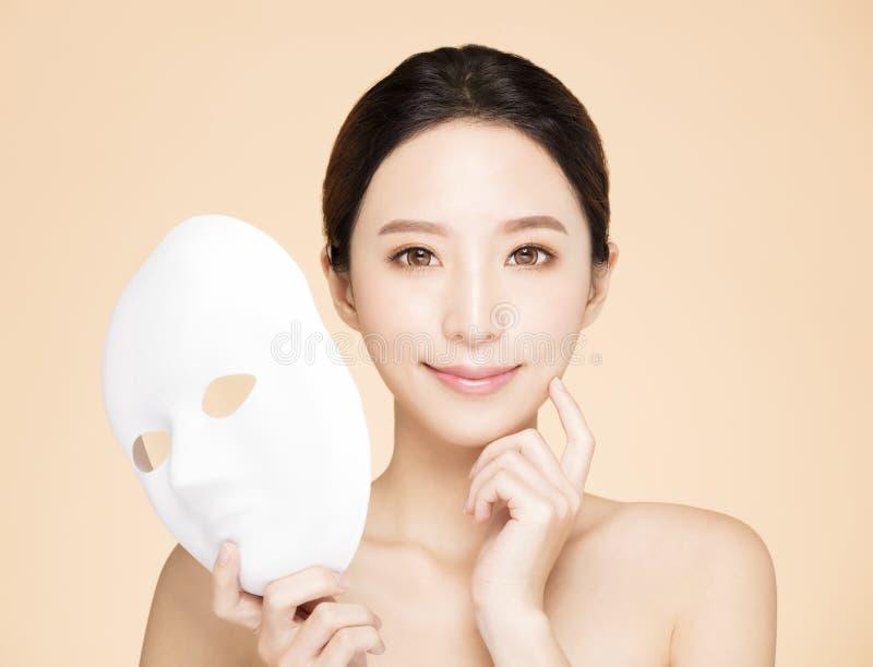 Beauty face with facial mask concept stock photos