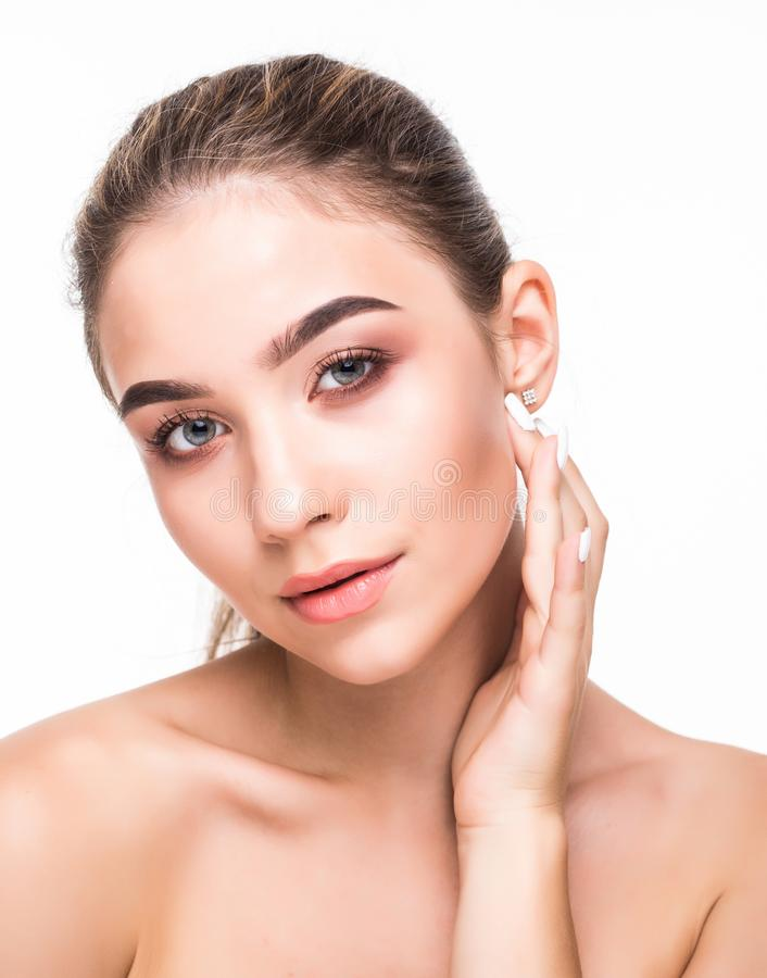 Closeup beauty girl face with natural nude makeup and clean skin isolated on white background. Skincare facial treatment concept. stock photography