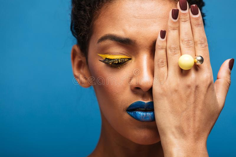 Closeup beauty photo of relaxed mixed-race woman with fancy make royalty free stock photos